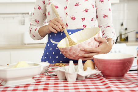 baking cake: Woman Baking In Kitchen