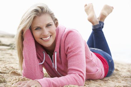 casual hooded top: Woman Relaxing On Beach