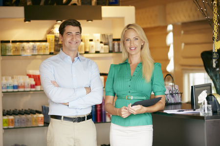 Portrait Of Beauty Product Shop Managers Holding Digital Tablet