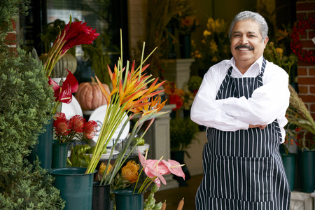 business owner: Portrait Of Male Florist Outside Shop Stock Photo