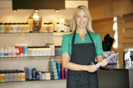 sales assistant: Portrait Of Sales Assistant In Beauty Product Shop Stock Photo