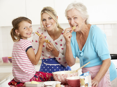 baking ingredients: Mother,Daughter And Grandmother Baking In Kitchen