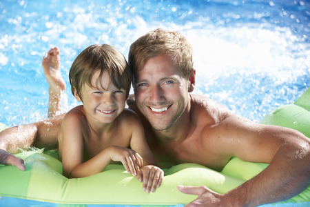 father and children: Father And Son On Holiday In Swimming Pool