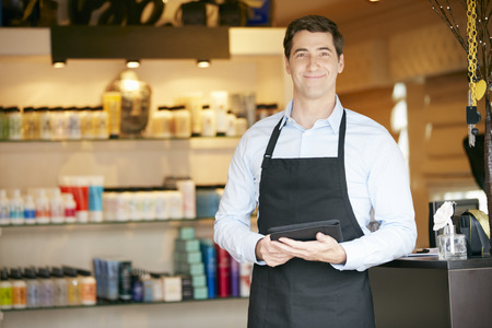 sales assistant: Portrait Of Male Sales Assistant In Beauty Product Shop