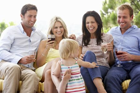 mothers group: Group Of Friends Sitting On Outdoor Seat Together With Young Girl