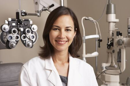 optician: Portrait Of Female Optician In Surgery Stock Photo