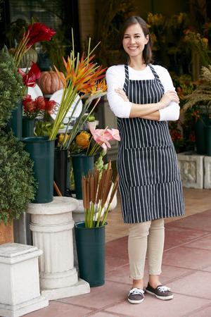 Portrait Of Female Florist Outside Shop Stock fotó