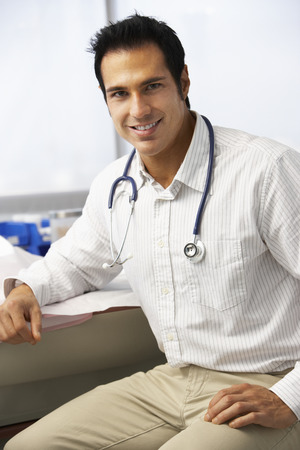 surgery table: Portrait Of Male Doctor In Surgery Stock Photo