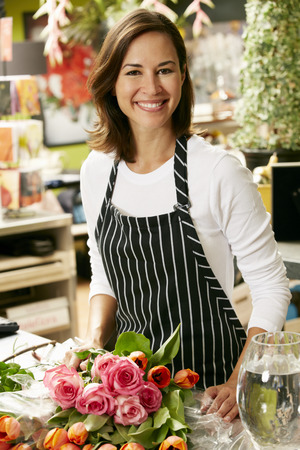 florist shop: Portrait Of Female Florist In Shop Stock Photo