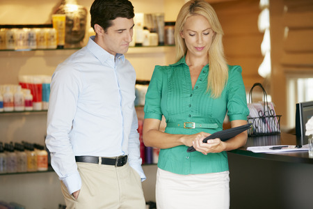 Portrait Beauty Product Shop Managers Using Digital Tablet
