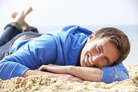 casual hooded top: Man Relaxing On Beach