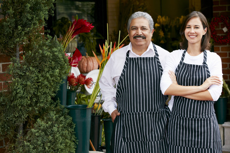 business women: Portrait Of Male And Female Florist Outside Shop