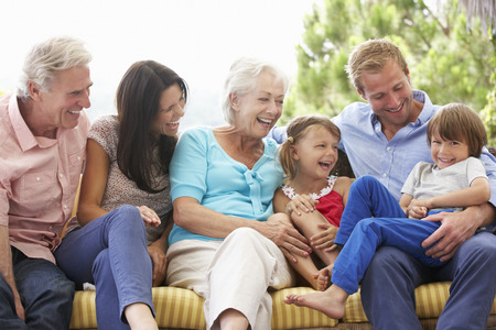 grandchildren: Multi Generation Family Sitting On Garden Seat