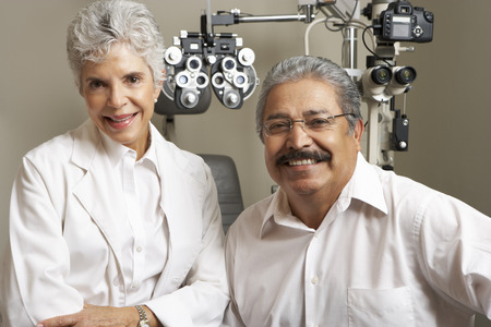 optician: Portrait Of Female Optician With Patient In Surgery