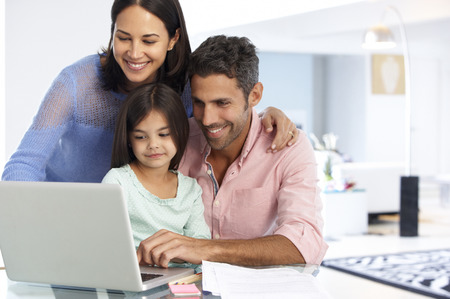 guy with laptop: Family Working At Laptop With In Home Office