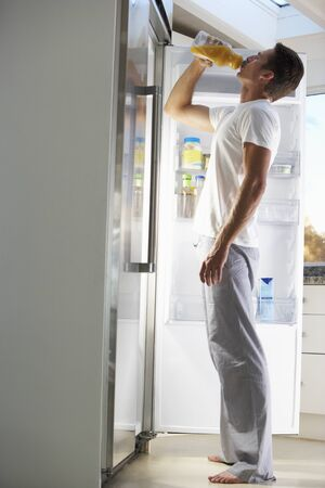 guilty pleasure: Man Raiding The Fridge For Drink At Night