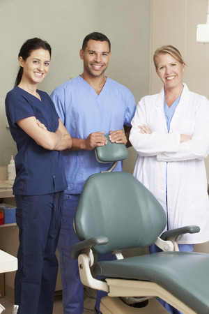dentists: Portrait Of Dentist And Dental Nurses In Surgery
