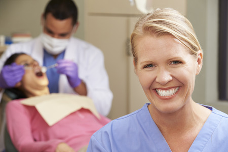 dental nurse: Portrait Of Dentist And Dental Nurse In Surgery Stock Photo