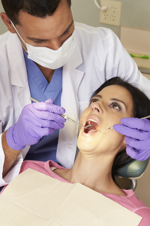 check up: Woman Having Check Up At Dentists Surgery