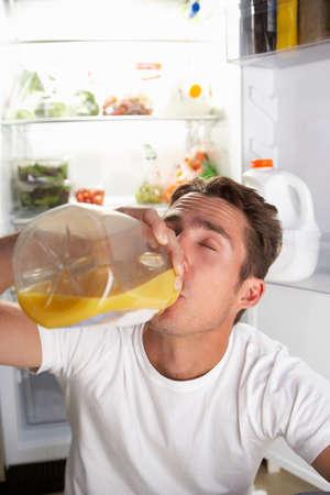 guilty pleasure: Man Raiding The Fridge For Drink At Night