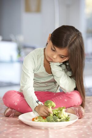 rejecting: Unhappy Young Girl Rejecting Plate Of Fresh Vegetables