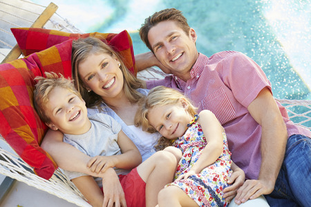 relax: Family Relaxing In Garden Hammock Together