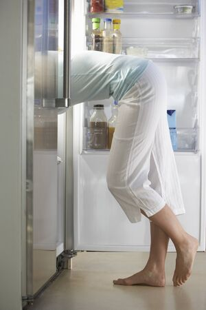 fridge: Woman Raiding The Fridge At Night