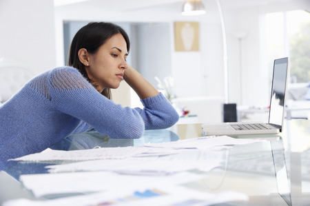 stressed people: Stressed Woman Working At Laptop In Home Office