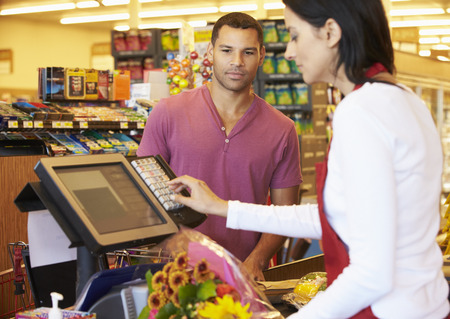paying: Customer Paying For Shopping At Supermarket Checkout