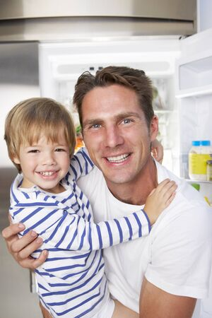 guilty pleasure: Father And Son Getting Snack From The Fridge