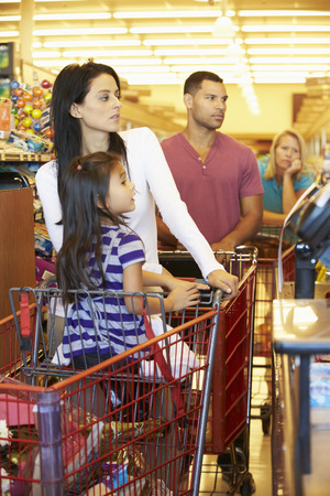supermarket checkout: Customer In Queue To Pay For Shopping At Supermarket Checkout