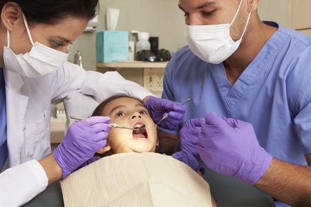 Young Girl Having Check Up At Dentists Surgery