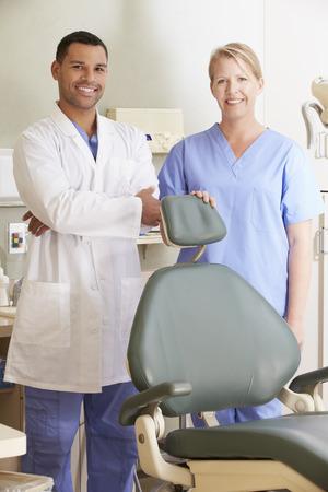 dental nurse: Portrait Of Dentist And Dental Nurse In Surgery Stock Photo