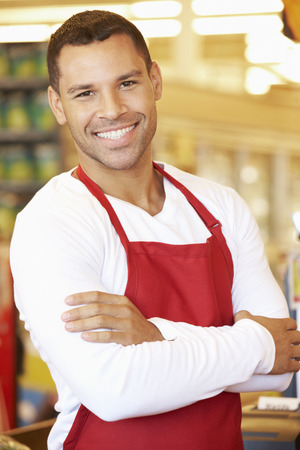 supermarket checkout: Male Cashier At Supermarket Checkout Stock Photo