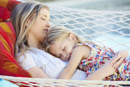 hammock: Mother And Daughter Sleeping In Garden Hammock Together Stock Photo