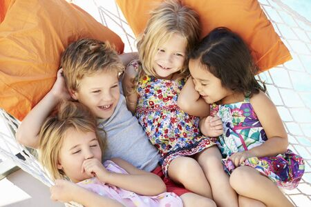 4 5 year old: Four Children Relaxing In Garden Hammock Together