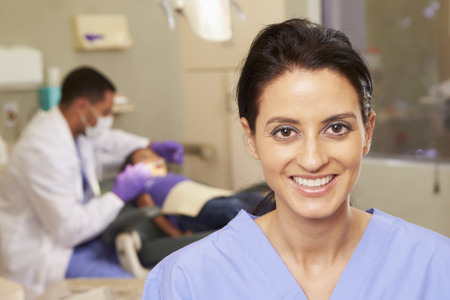 dentist mask: Portrait Of Dental Nurse In Dentists Surgery