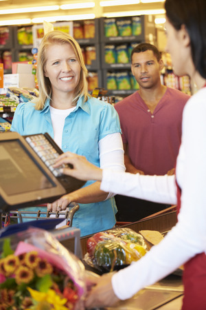 retail store: Customer Paying For Shopping At Supermarket Checkout