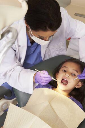 check up: Young Girl Having Check Up At Dentists Surgery
