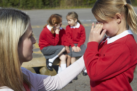 casualty: Teacher Comforting Victim Of Bullying In Playground