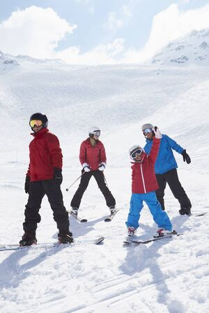 dad son: Family On Ski Holiday In Mountains