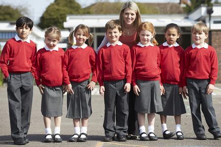 pupils: Elementary School Pupils With Teacher In Playground