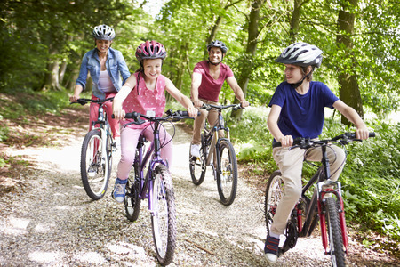 9 year old girl: Family On Cycle Ride In Countryside Stock Photo