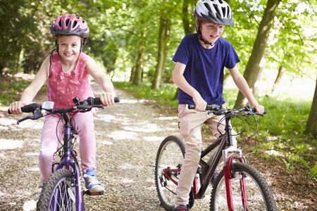 11 year old girl: Two Children On Cycle Ride In Countryside Stock Photo