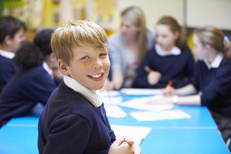 child portrait: Portrait Of Pupil In Classroom With Teacher