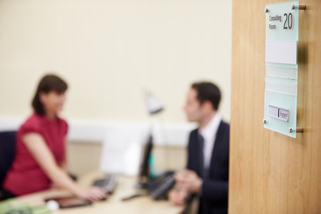 office meeting: Consultant Meeting With Patient In Office Stock Photo