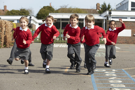 uniforms: Elementary School Pupils Running In Playground