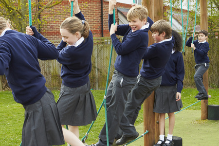 school playground: Elementary School Pupils On Climbing Equipment