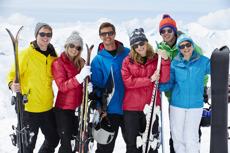 happy group: Group Of Friends Having Fun On Ski Holiday In Mountains Stock Photo