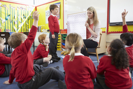 Teacher Teaching Maths To Elementary School Pupils